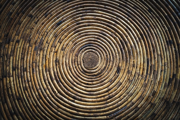 Circular texture of a bamboo bowl. under a bamboo roof. twisted into a spiral bamboo