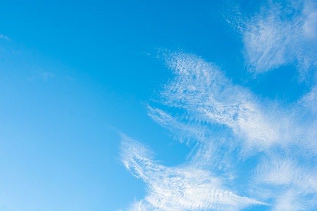 Cirrus clouds on blue sky background.