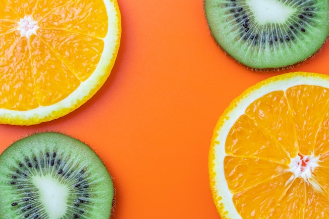 Citrus background, sliced orange and kiwi. Tropical fruits pattern, wallpaper