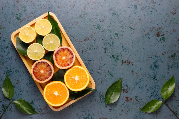 Citrus background with assorted fresh-citrus fruits
