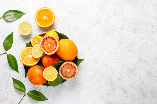 Citrus background with assorted fresh citrus fruits