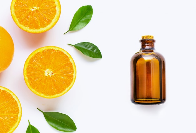 Citrus essential oil with fresh orange fruit isolated on white