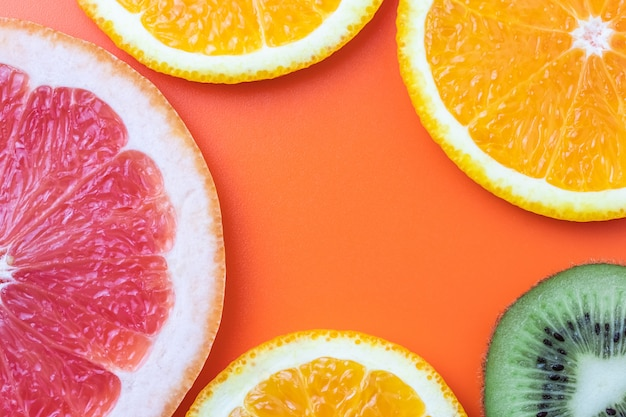 Citrus fruit background, slices of grapefruit, kiwi, mandarin. summer template