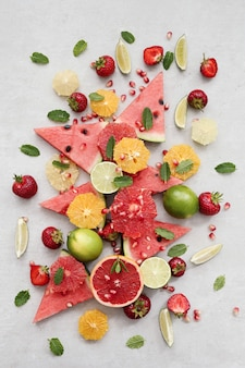 Citrus fruits, berries, watermelon and leaves