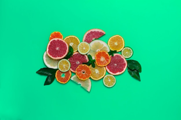 Citrus fruits, on a green background, top view , horizontal , no people,. high quality photo