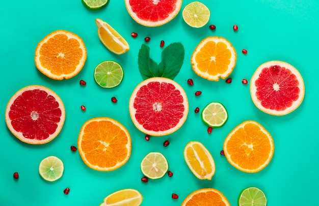 Citrus fruits, on a green background, top view , horizontal ,