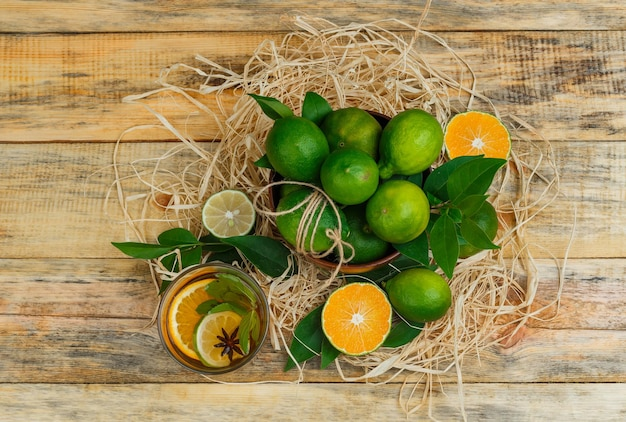 Citrus fruits in a pot with herbal tea
