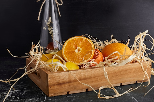 Citrus fruits in a rustic tray.
