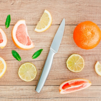 Citrus fruits scattered on wooden table