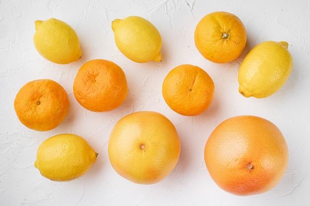감귤류 과일 세트, 흰색 돌 테이블 배경, 평면도 평면 누워