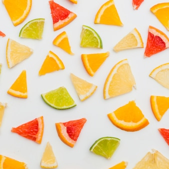 Citrus fruits slices isolated on white background