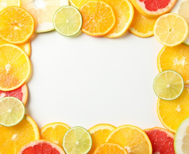 Citrus fruits slices on white background, space for text