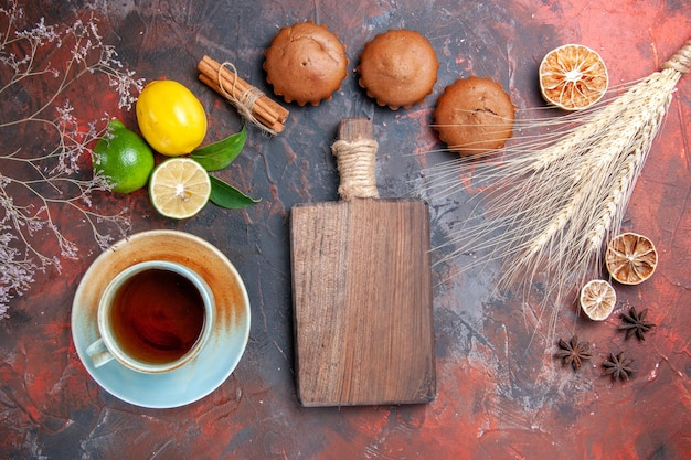 Citrus fruits wheat ears cupcakes citrus fruits a cup of tea the cutting board