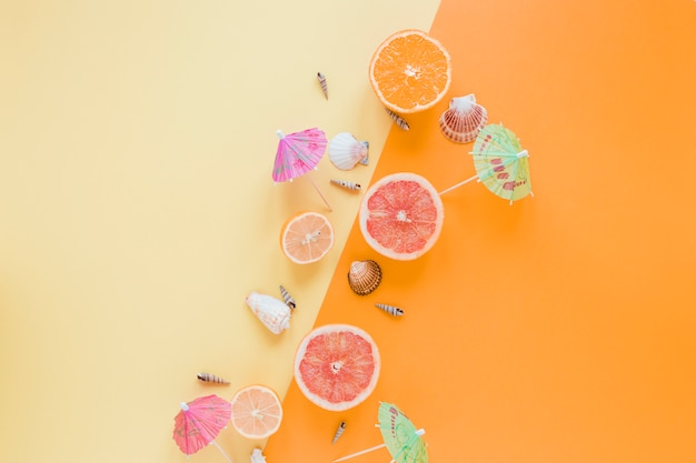 Citrus fruits with sea shells and cocktail umbrellas