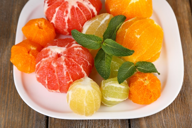 Citrus fruits without skin, on plate