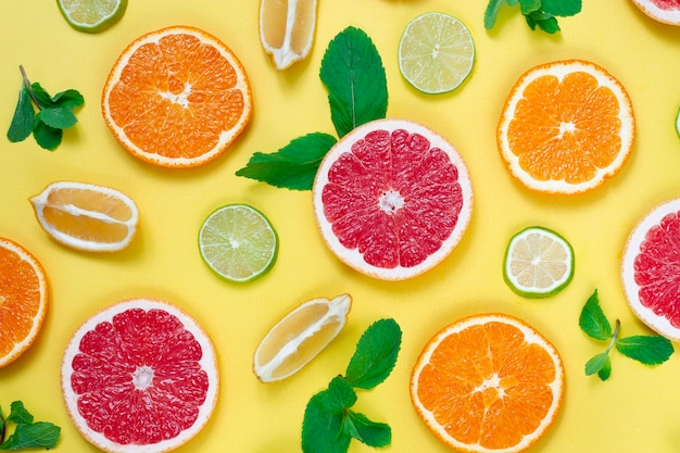 Citrus fruits, on a yellow background, top view , horizontal ,