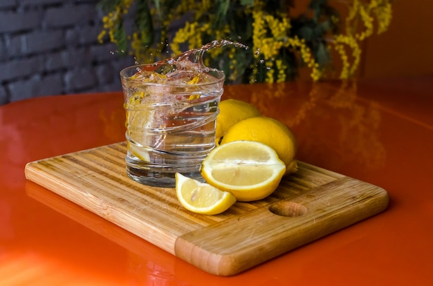 Citrus lemonade. a glass of refreshing water with lemon slices to quench your thirst
