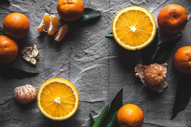 Citrus on table: mandarin, tangerine with a knife. fresh organic juicy. wholesome healthy food