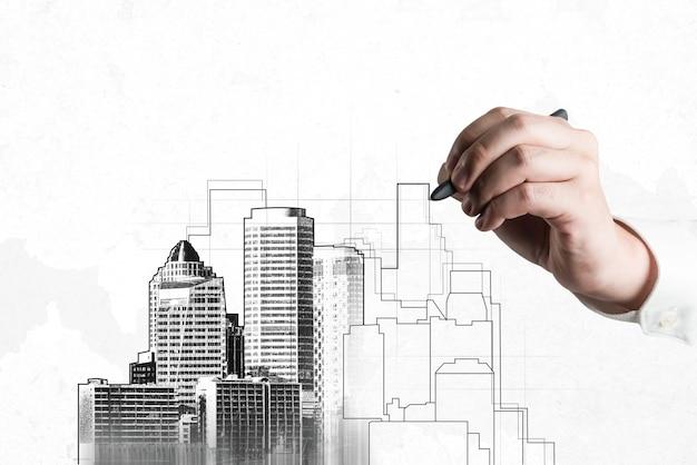 도시 토목 계획 및 부동산 개발-창조적 인 미래 도시 건물을 디자인하기 위해 추상 도시 스케치 드로잉을보고 건축가 사람들. 건축 꿈과 야망 개념.