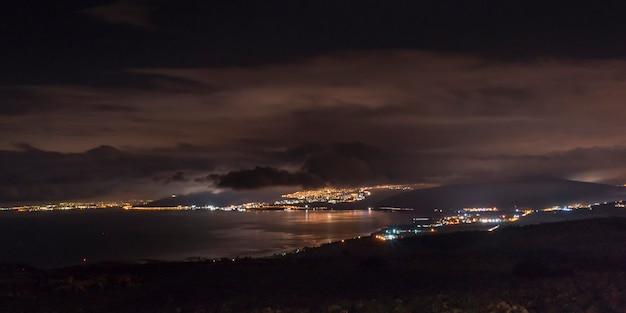 City at coast lit up at night, vered hagalil, sea of galilee, galilee, israel