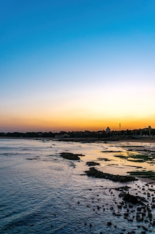 City coastline reef and sunset  landscape