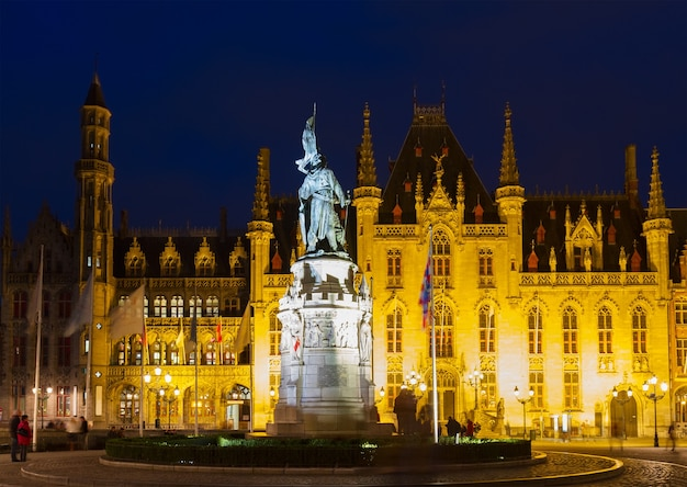 City hall and grote markt square  at night, bruges, belgium