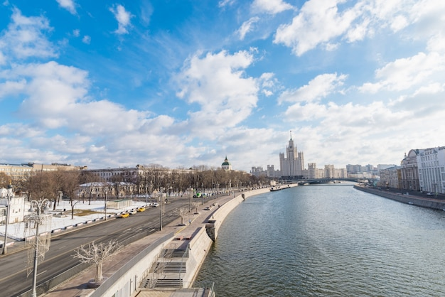 City landscape with view on moscow kremlin and reflections in waters of moskva river.