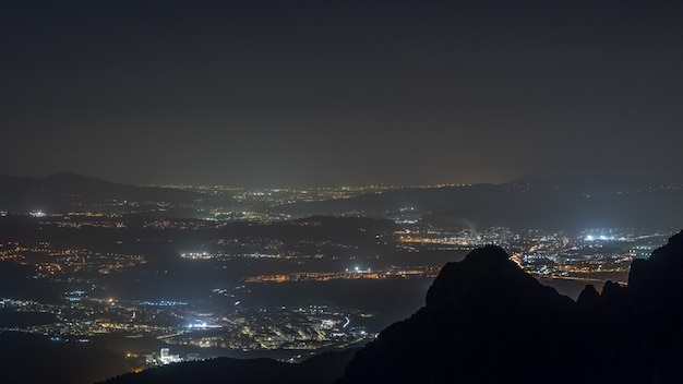 City lights by night seen from mountains