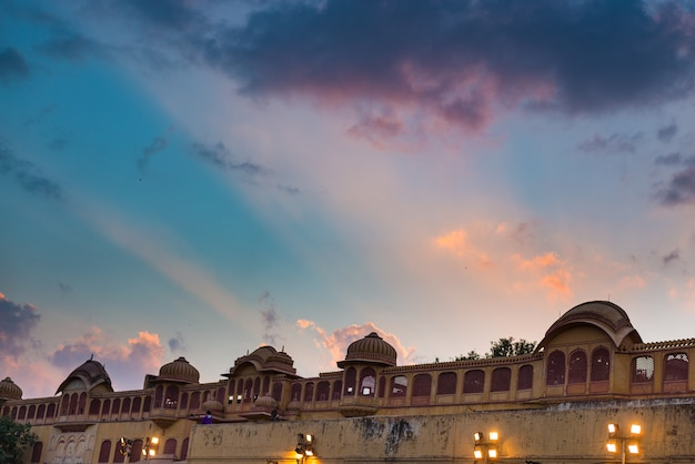 City palace at jaipur, capital city of rajasthan, india. architectural details with scenic dramatic sky at sunset.