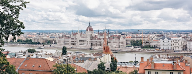 City panorama with hungarian parliament, danube river. budapest, hungary