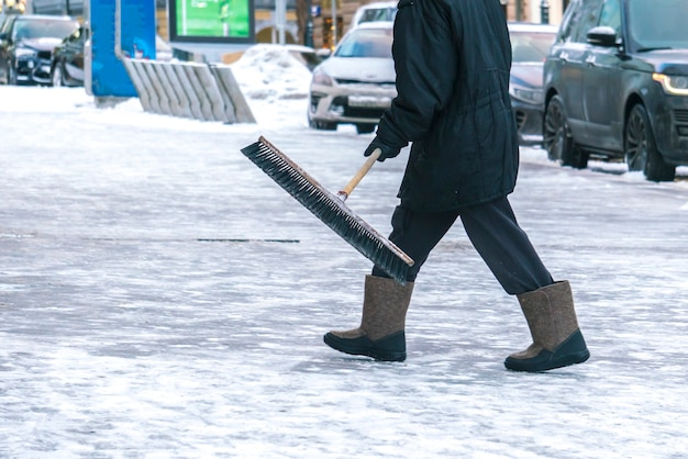 City service cleaning streets from snow with special tools after snowfall b