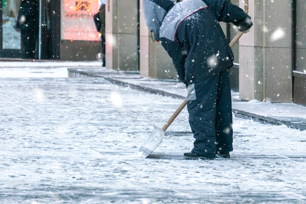 City service cleaning streets from snow with special tools after snowfall d