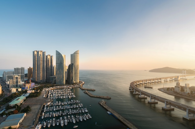 City skyline view at haeundae district, gwangalli beach with yacht pier at busan, south korea