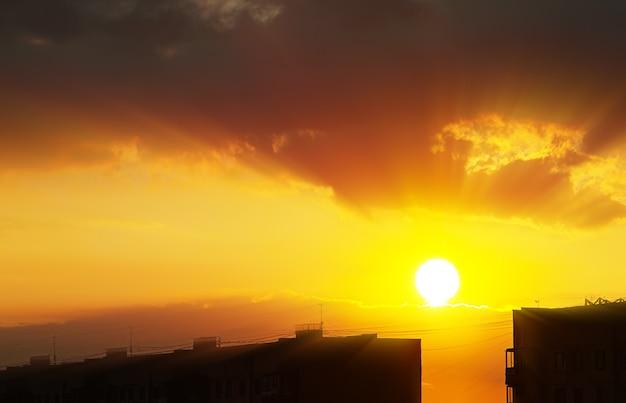 City skyline with dramatic sunset light rays background