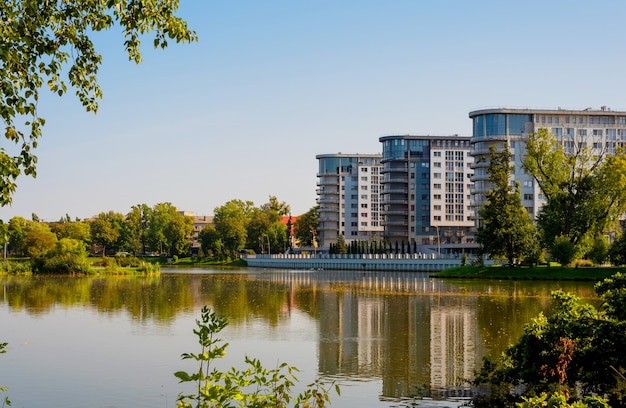 City south park in kaliningrad on a sunny afternoon fallen leaves float in the lake