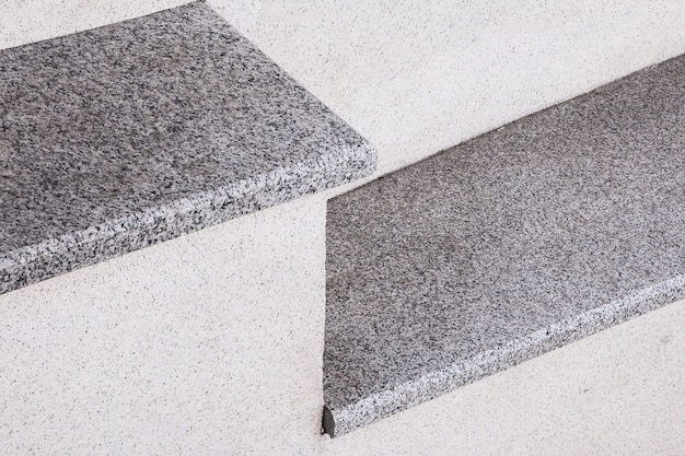 The city staircase is made of gray stone and granite an element of urban architecture