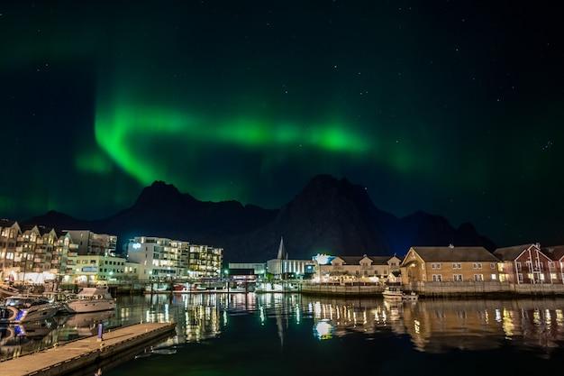 City svolvaer with aurora borealis in lofoten, norway