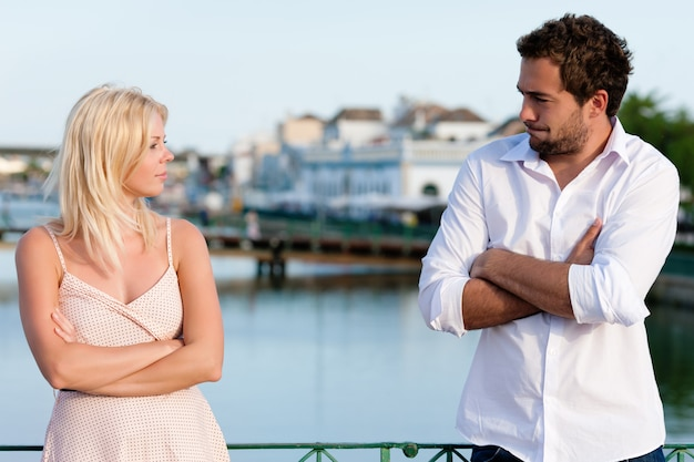 City tourism - couple in vacation having discussion
