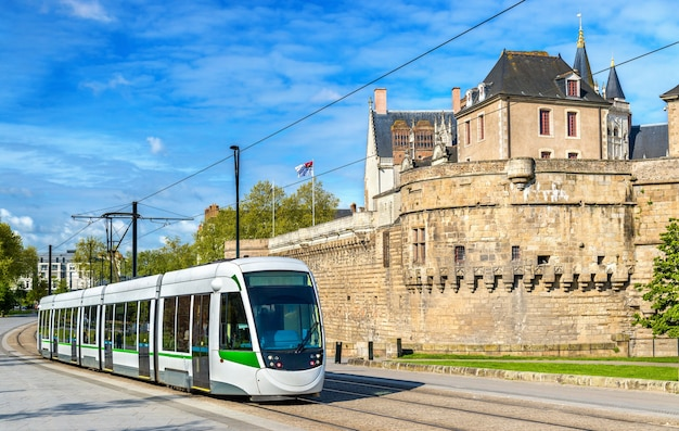 City tram at the castle of the dukes of brittany in nantes