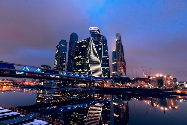 City view landscape on the towers of skyscrapers moscow city and bagration bridge by the river