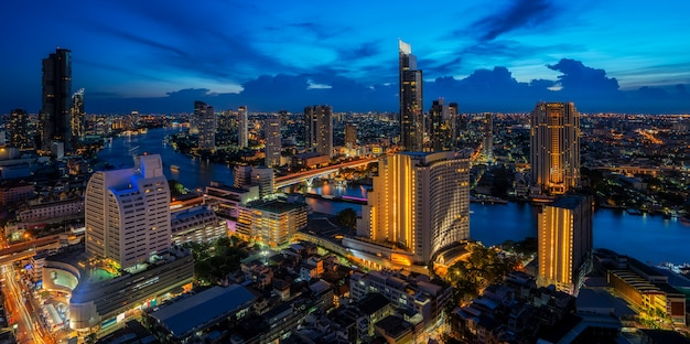 Cityscape in bangkok city from roof top bar in hotel with chao phraya river