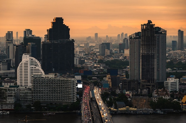 Cityscape of building with car traffic on the bridge in the monring at business district. bangkok, thailand