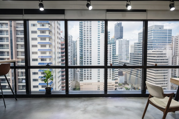 Cityscape of business office in downtown from empty coworking space temporarily closed at bangkok