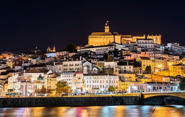 Cityscape of coimbra above the mondego river in portugal