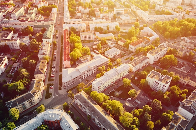 Cityscape of gomel, belarus. aerial view of town architecture. city streets at sunset, bird eye view
