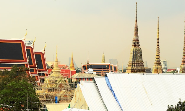 Cityscape image, famous temple with many style house in center of bangkok city