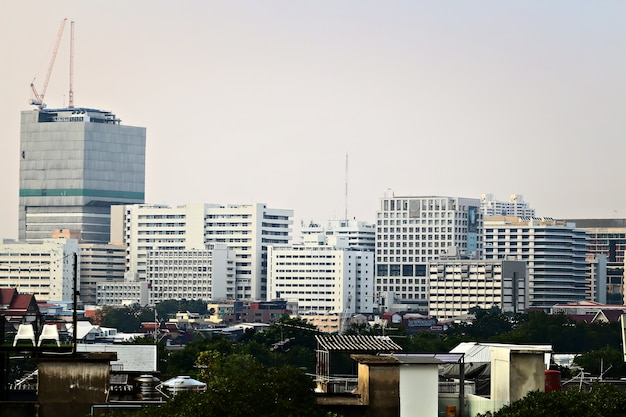 Cityscape image, many giant building with many style house in center of city