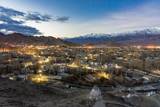 Cityscape leh city or downtown with mountain background from santi stupa at leh, india