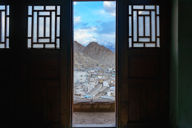 Cityscape leh city or downtown with mountain background from the window of leh palace at leh, india