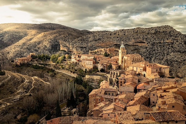 Cityscape of the medieval city of albarracãn with its old stone houses, churches and atmosphere of an ancient town between mountains. teruel, aragon, spain. europe.